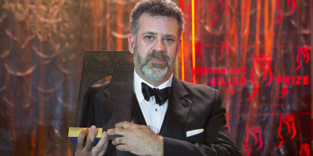 """Author Michael Redhill celebrates winning the 2017 Giller Prize for his novel """"Bellevue Square"""" in Toronto on Monday."""