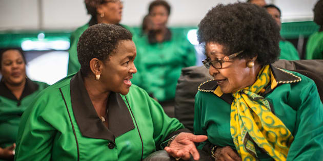 Africa National Congress stalwart Winnie Madikizela Mandela (R) listens to ANC Women League president Bathabile Dlamini while supporters gather in Soweto on September 26, 2016, to celebrate her 80th birthday.