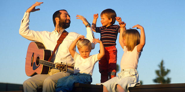 Raffi Cavoukian, better known by Raffi, entertains some children after a concert Sept. 10, 1989 in Los Angeles, California.