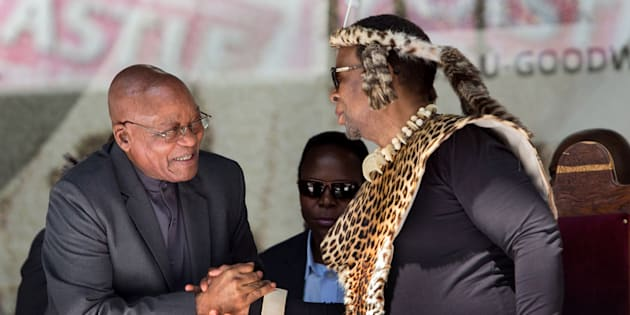 President Jacob Zuma (L) greets Zulu King Goodwill Zwelithini at the Moses Mabhida Football stadium to celebrate South Africa's Heritage Day in Durban on September 24, 2016.