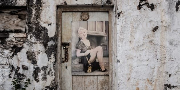 A picture of the late American actress Marylin Monroe is pasted on a door of a Ladder's Hill fort house on October 20, 2017 in Saint Helena, a British Overseas Territory in the South Atlantic Ocean. / AFP PHOTO / GIANLUIGI GUERCIA        (Photo credit should read GIANLUIGI GUERCIA/AFP/Getty Images)