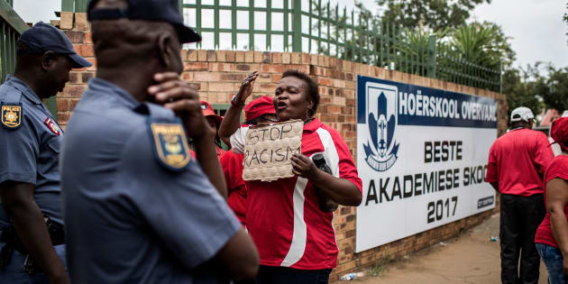 A member of SADTU faces policemen during protests at Hoërskool Overvaal in Vereeniging.  January 22, 2018