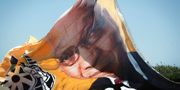 A photo shows a flag of the African National Congress (ANC) with a portrait of President Jacob Zuma before it is flown over New Year's day revellers and holidaymakers on Durban Beach during New Year festivities in Durban on January 1, 2017.