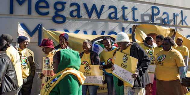 Members of South African political party Congress of the People (Cope) demonstrate outside state entity Eskom Offices at Megawatt Park.
