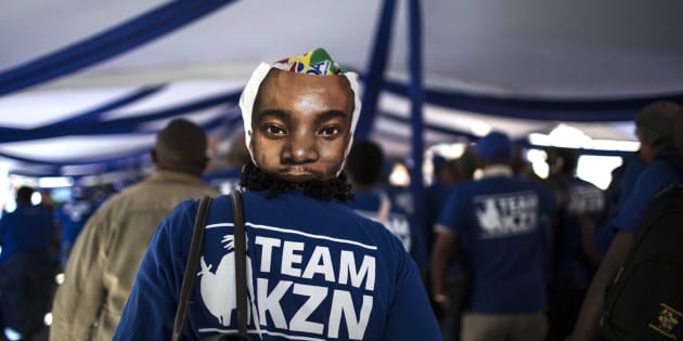 A supporter of South Africa's main opposition Democratic Alliance (DA) party is pictured wearing a mask featuring DA's leader Mmusi Maimane during a party conference on April 7, 2018 in Pretoria.  Main opposition Democratic Alliance holds conference amid spat with a former coalition partner and surge in support for ruling African National Congress (ANC). / AFP PHOTO / GULSHAN KHAN        (Photo credit should read GULSHAN KHAN/AFP/Getty Images)