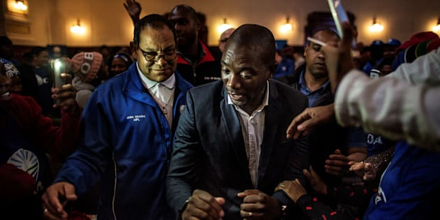 South African opposition party Democratic Alliance (DA) provincial leader John Moodey (L) looks on as Mmusi Maimane, the leader of the DA party dances with supporters during a rally at the Johannesburg City Hall in 2016.  Photo: MARCO LONGARI/AFP/Getty Images