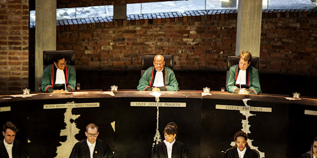 South African Chief Justice Mogoeng Mogoeng leads a session of the Constitutional Court, on March 17, 2017, in Johannesburg, aimed at delivering a ruling to resolve the social grant payment crisis, two weeks before the deal then in place expired.  / AFP PHOTO / MARCO LONGARI        (Photo credit should read MARCO LONGARI/AFP/Getty Images)