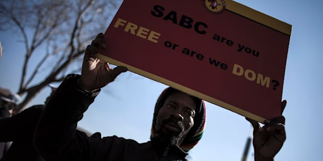 A Protester rallies with others outside the Constitutional Court on 1 July 2016 in Johannesburg to protest against alleged bias and self-censorship in news coverage by the South African Broadcasting Corporation (SABC) ahead of key municipal elections.