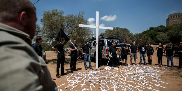 Members of the South African civic organisation, Afriforum and others in solidarity with the #Blackmonday movement pray during a demonstration against farm murders, at the Voortrekker Monument in Pretoria on October 30, 2017. Thousands of white farmers blocked roads in South Africa on Monday to protest against what they say is an explosion of violence against their communities in rural areas. Large demonstrations under the 'Black Monday' banner were held in Cape Town, Johannesburg and the capital Pretoria. Marchers dressed in black to commemorate the victims of hundreds of deadly 'farm attacks' in recent years. / AFP PHOTO / GULSHAN KHAN        (Photo credit should read GULSHAN KHAN/AFP/Getty Images)