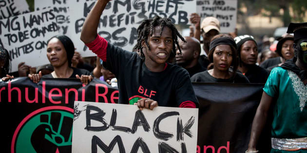 Members of political party Black First Land First (BLF) march to the offices of financial audit, tax and advisory company KPMG on September 28, 2017 in Johannesburg, South Africa.