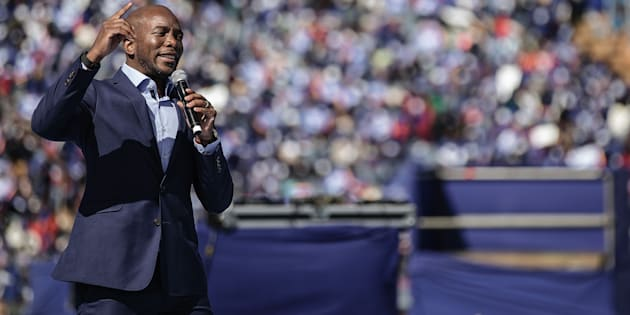 South African main opposition party Democratic Alliance leader Mmusi Maimane gestures as he gives his speech during the final Municipal Elections campaign rally at Dobsonville Stadium in Soweto, on July 30, 2016.