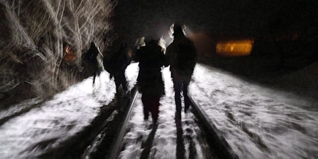 Early Sunday morning, Feb. 26, 2017, eight migrants from Somalia cross into Canada illegally from the United States by walking down this train track into the town of Emerson, Man., where they will seek asylum at Canada Border Services Agency.