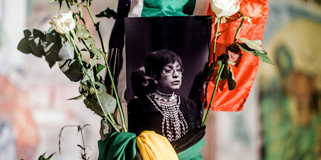 South Africans gather to pay respect to Mam' Winnie during a candle vigil in Durban on April 2, 2018.