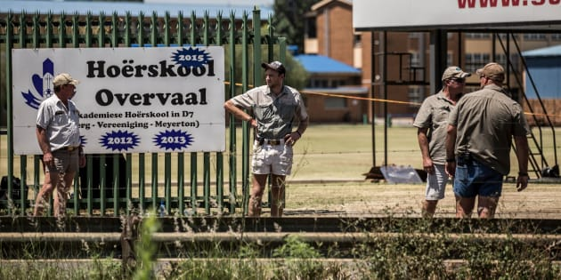Pupils' parents watch protests against Hoërskool Overvaal in Vereeniging on January 19, 2018.