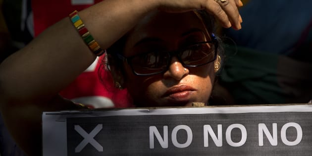 An Indian women holds a banner during a protest against sexual harassment in the workplace in New Delhi, India, Friday, Oct. 12, 2018. Indian actresses and writers are flooding social media with allegations of sexual harassment and assault, releasing pent-up frustration with a law that was lauded internationally but that critics say has done little to change the status quo in the world's largest democracy. (AP Photo/Manish Swarup)