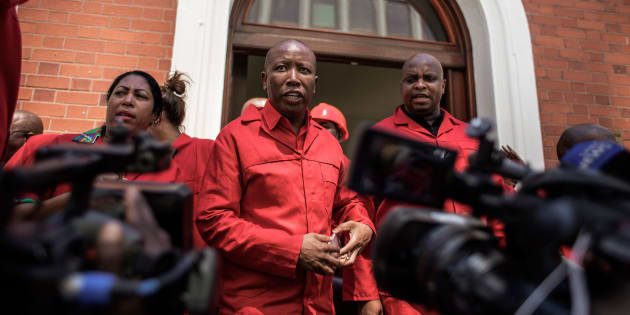EFF leader Julius Malema (C) talks to the press after staging a walk out during the election by the Members of Parliament of the new South African President on February 15, 2018 in Cape Town.