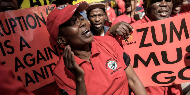 Cosatu members cheer and dance as they march through the streets protesting against corruption on September 27, 2017 in Johannesburg.
