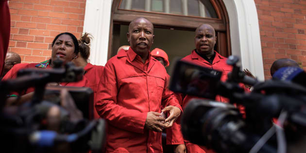 South African opposition party Economic Freedom Fighters (EFF) leader Julius Malema (C) talks to the press after staging a walk out during the election by the Members of Parliament of the new South African President on February 15, 2018 in Cape Town.