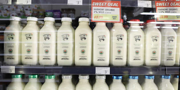 Bottles of milk are displayed at The Sweet Potato in Toronto on April 5, 2018.