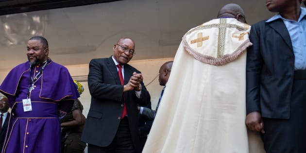Jacob Zuma greets South African religious leaders and a crowd of supporters before addressing them outside the KwaZulu-Natal High Court in Durban on April 6 2018.