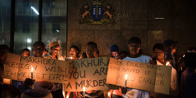 Relatives and family members of some of the 94 mentally ill patients who died last year, hold a candle light vigil organized by South African main opposition party Democratica Alliance (DA) outside the Gauteng Province premier office on February 2, 2017 in Johannesburg.