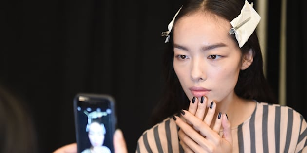 NEW YORK, NY - SEPTEMBER 13:  A model prepares backstage at the Vera Wang Collection fashion Show during New York Fashion Week: The Shows at The Arc, Skylight at Moynihan Station on September 13, 2016 in New York City.  (Photo by Nicholas Hunt/Getty Images for New York Fashion Week: The Shows)