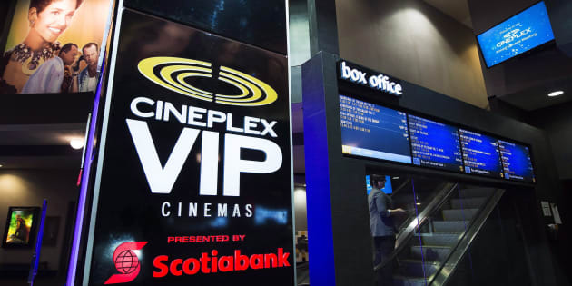 An employee makes her way up the escalator during the Cineplex Entertainment company's annual general meeting in Toronto on Wednesday, May 17, 2017. Cineplex is working to attract more customers to its theatres after a lacklustre summer at the box office.