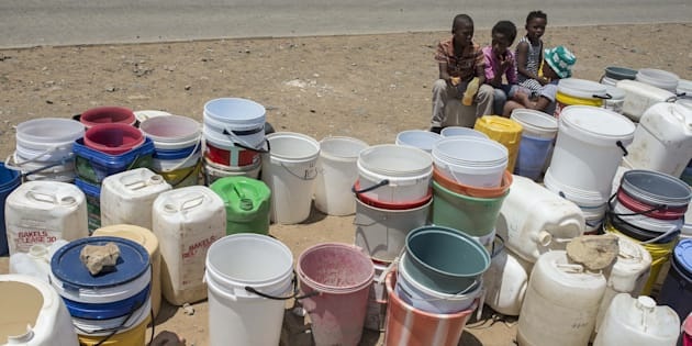 Children wait to fill their cans with water in the Free State, South Africa, during last year's drought.