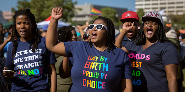 Members of the South African Lesbian, Gay, Bisexual and Transgender and Intersex (LGBTI) community chant slogans as they take part in the three-day Durban Pride Festival.