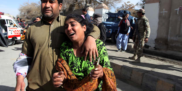 A man and a woman react as they run out after gunmen attacked the Bethel Memorial Methodist Church in Quetta, Pakistan December 17, 2017. REUTERS/Naseer Ahmed