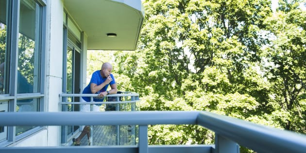 Gerald Major, 46, uses a vaporizer with medical marijuana on his back balcony at his condo in Oakville, Ont., on July 17, 2018.