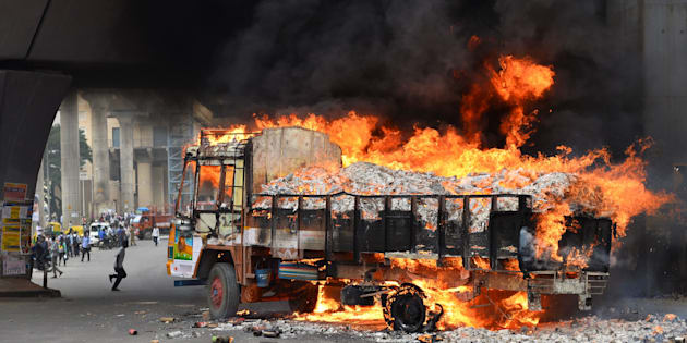 A truck from Tamil Nadu burns after it was set alight by agitated pro-Karnataka activists  in Bangalore on September 12, 2016.