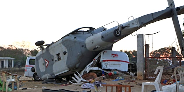 The remains of a military helicopter that fell on a van in Santiago Jamiltepec, Oaxaca state, Mexico, on Saturday.