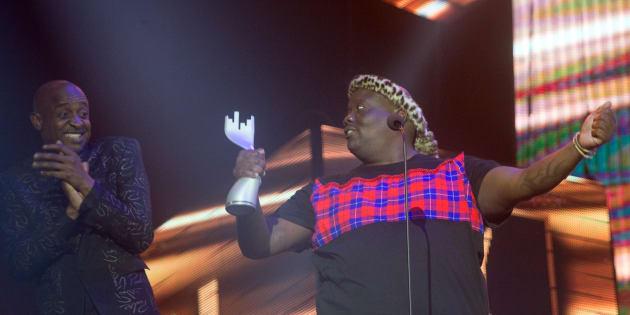 L'vovo derrango celebrates receiving the 'Best Kwaito Album' from Arthur Mafokate during the 16th annual Metro FM Music Awards.