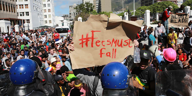 South African students protest outside Parliament on October 21, 2015, in Cape Town.