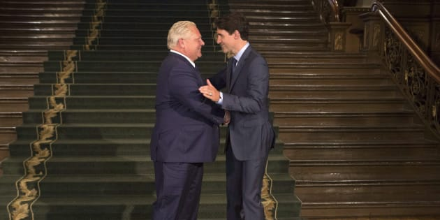Ontario Premier Doug Ford greets Prime Minister Justin Trudeau at the Ontario legislature in Toronto on July 5, 2018.