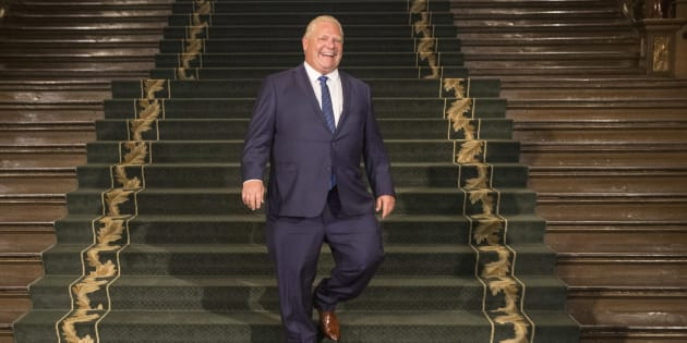 Ontario Premier Doug Ford walks down the grand staircase as he waits for Prime Minister Justin Trudeau at the Ontario legislature in Toronto on July 5, 2018.