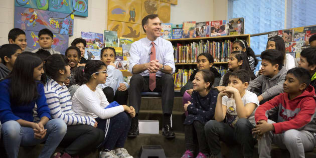 Federal Finance Minister Bill Morneau speaks with students from Toronto's Rose Avenue Junior Public School before a pre-budget photo opportunity in Toronto on Feb. 23, 2018.