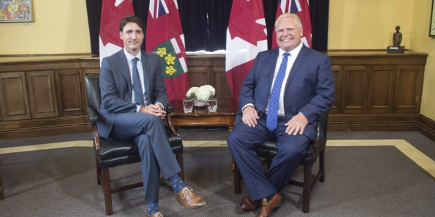 Prime Minister Justin Trudeau sits with Ontario Premier Doug Ford at the Ontario Legislature in Toronto on July 5, 2018.