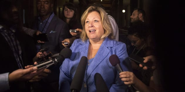 Ontario Education Minister Lisa Thompson scrums with reporters at the Queens Park legislature in Toronto on Aug. 9, 2018.