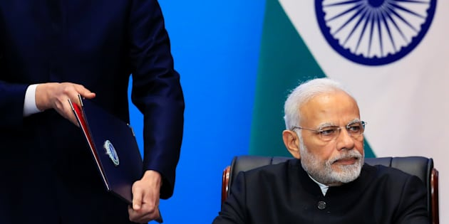 India's Prime Minister Narendra Modi attends a signing ceremony during Shanghai Cooperation Organization (SCO) summit in Qingdao, Shandong Province, China June 10, 2018. REUTERS/Aly Song