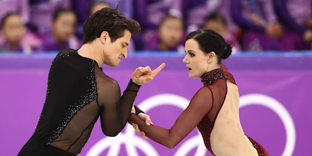 Tessa Virtue and Scott Moir of Canada compete in the free dance segment of the ice dance.