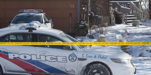 Police stand guard at a house on Mallory Crescent in Toronto on Jan. 30, 2018. Police are investigating the property in relation to the murder charges laid against Bruce McArthur.