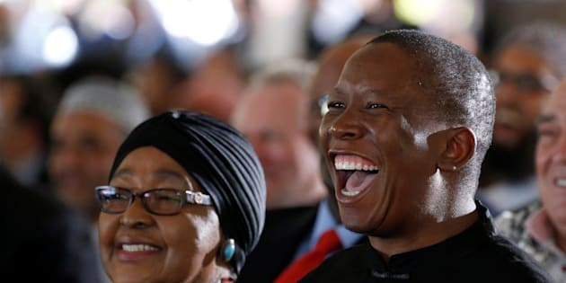 Winnie Madikizela-Mandela (L) and Leader of the Economic Freedom Fighters Julius Malema react during the funeral of Ahmed Kathrada, who was sentenced to life imprisonment alongside Nelson Mandela, at the Westpark Cemetery in Johannesburg, South Africa March 29, 2017. REUTERS/Siphiwe Sibeko