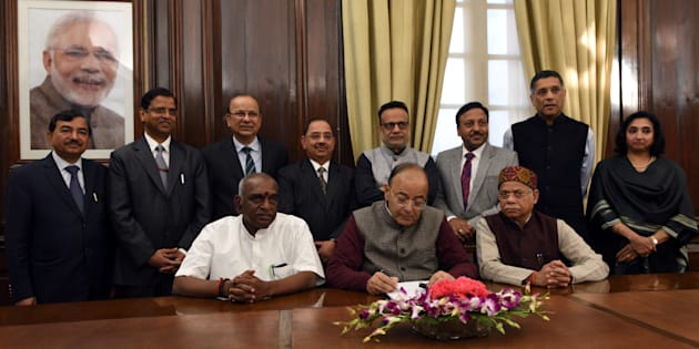 Union Finance Minister Arun Jaitley along with Shiv Pratap Shukla (R), P Radhakrishnan (L) along with Chief Economic Advisor Arvind Subramanian, Rajiv Kumar, Secretary (Financial Services), Hasmukh Adhia, Finance Secretary & Secretary (Revenue), Neeraj Kumar Gupta, Secretary (Investment and Public Asset Management) Ajay Narayan Jha, Secretary (Expenditure) and Subhash Chandra Garg, Secretary (Economic Affairs) ahead of Budget 2018-19 at Finance Ministry North Block on January 31, 2018 in New Delhi, India.