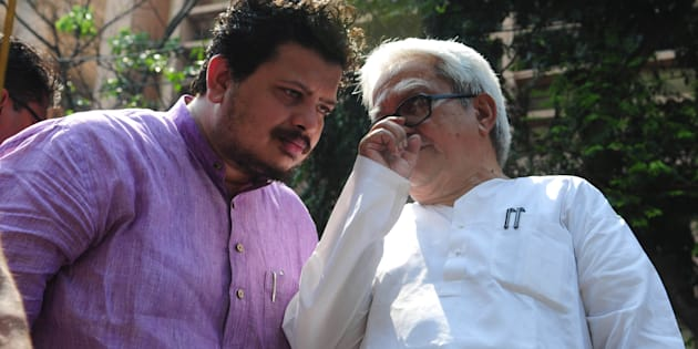 Ritabrata Banerjee, Member of Parliament (Rajya Sabha) with Biman Basu CPIM leader during a rally called by four left student organisations - SFI, AISF, AISB, PSU started from College square ended with a law violation movement at Dharmata, on April 2, 2015 in Kolkata.