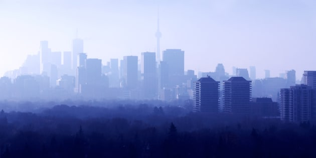 "Midtown Toronto on a foggy morning, with downtown in the background. A recent poll found that half of Torontonians are hoping for house prices to fall, but a new report from Royal Bank of Canada basically says ""don't hold your breath."""