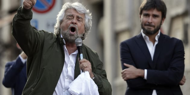 Five-Star Movement leader Beppe Grillo, left, is flanked by MP Alessandro Di Battista as he addresses a rally in Rome, Wednesday, Oct. 25, 2017. Italy's anti-establishment 5-Star Movement has filled a Rome piazza to protest the expected passage of a new electoral law that will likely hurt its chances in next year's elections. (AP Photo/Andrew Medichini)