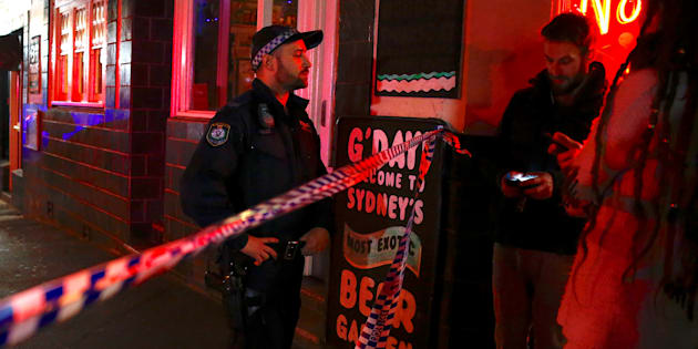 July 29, 2017: A policeman refuses to let members of the public walk onto a Sydney street that has been blocked to the public after a counter-terrorism raid.