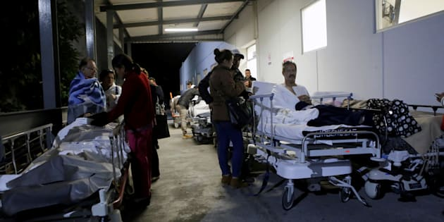 Patients and family members are seen outside the Institute for Social Security and Services for State Workers (ISSSTE) after an earthquake struck off the southern coast of Mexico late on Thursday, in Puebla, Mexico September 8, 2017.